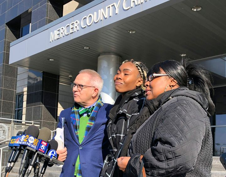 Jazmine Headley, center, joins attorney Brian Neary and her mother, Jacqueline Jenkins, outside a courthouse in Trenton, N.J.