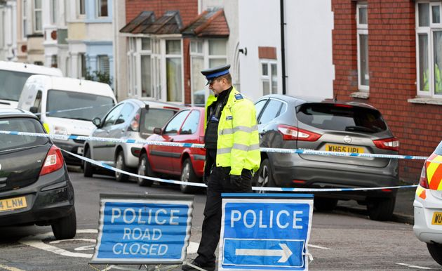 A PCSO stands on duty in Mansfield Street, Bedminister, Bristol, following the launch of a murder inquiry after the death of a 17-year-old-boy who was found fatally injured in the street.