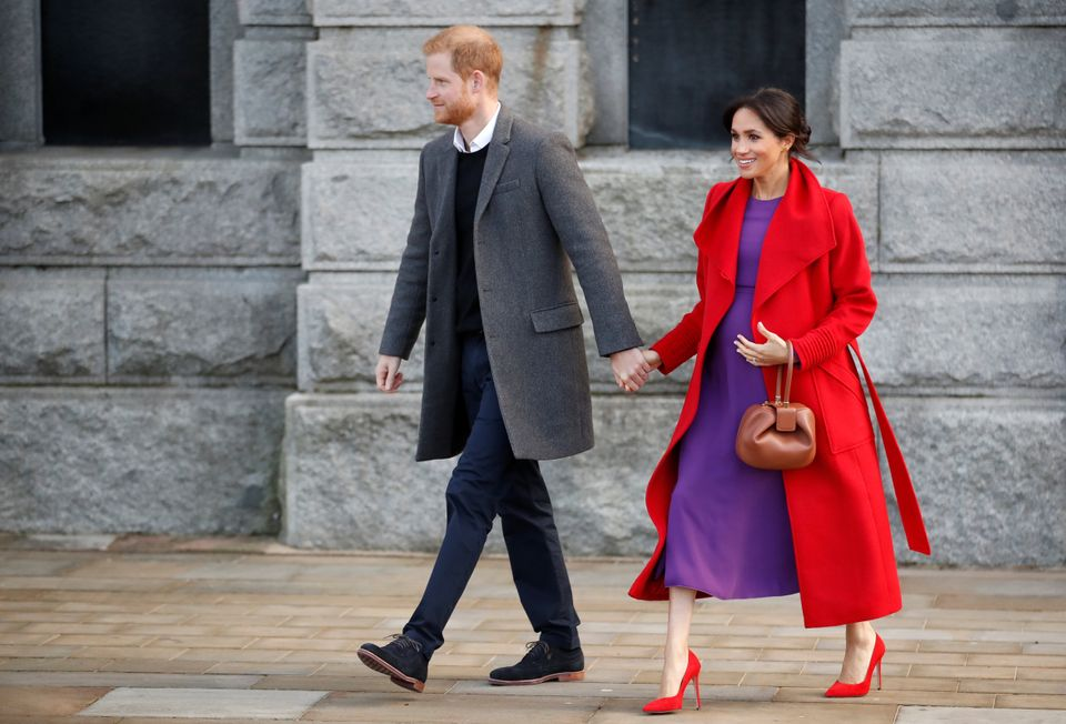 Prince Harry and Meghan, Duchess of Sussex, walk during their visit in Birkenhead, Britain.