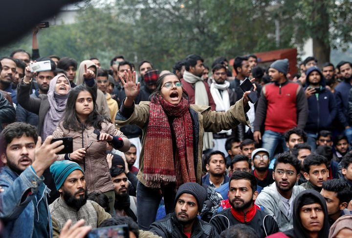 A student of the Jamia Millia Islamia university reacts during a demonstration after police entered the university campus on the previous day, following a protest against a new citizenship law, in New Delhi, India, December 16, 2019. REUTERS/Adnan Abidi