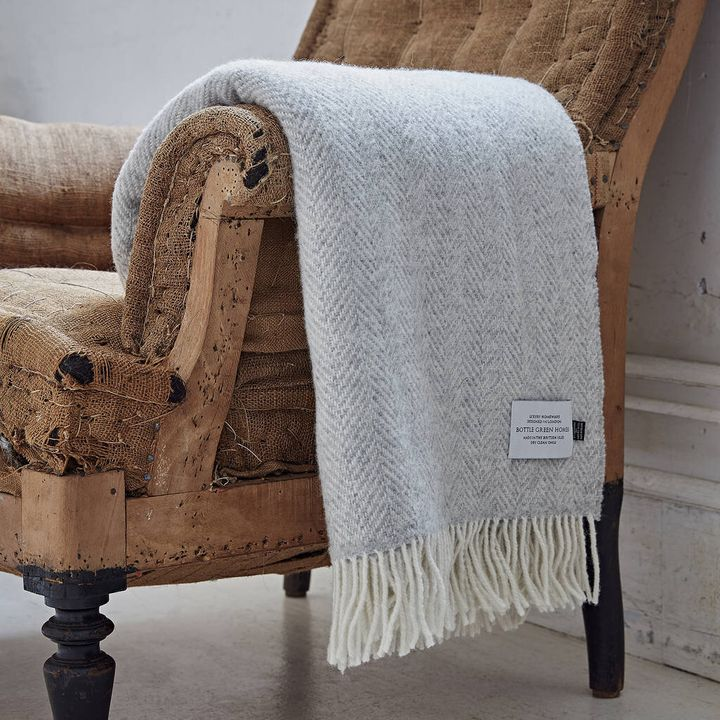"""<a href=""""https://fave.co/2swnKUm"""" target=""""_blank"""" rel=""""noopener noreferrer"""">&nbsp;Cashmere And Merino Light Grey Throw, Not On The High Street</a>, &pound;145"""