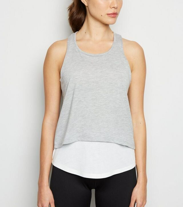 """<a href=""""https://fave.co/35rx1M9"""" target=""""_blank"""" rel=""""noopener noreferrer"""">Grey 2 In 1 Sports Vest, New Look,</a> &pound;12.99&nbsp;"""