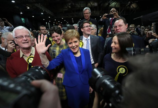 Nicola Sturgeon waves as she arrives at the SEC Centre in Glasgow for the election count on Friday.