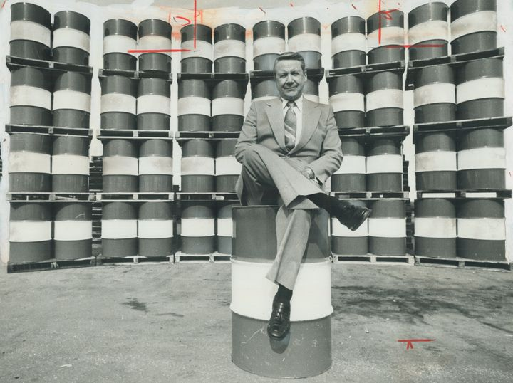 Every Canadian man, woman and child consumed on average each year the energy equivalent of these 49 barrels of crude oil pictured in 1977 with Imperial Oil's then-chairman John Armstrong.