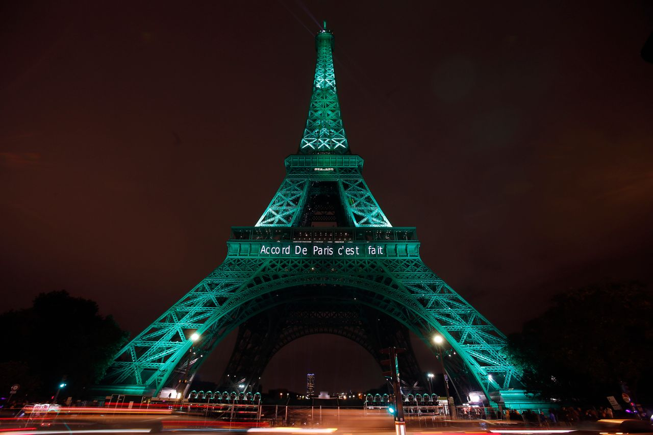 """The Eiffel tower is illuminated in green with the words """"Paris Agreement is Done"""" on Nov. 4, 2016 in Paris, France."""