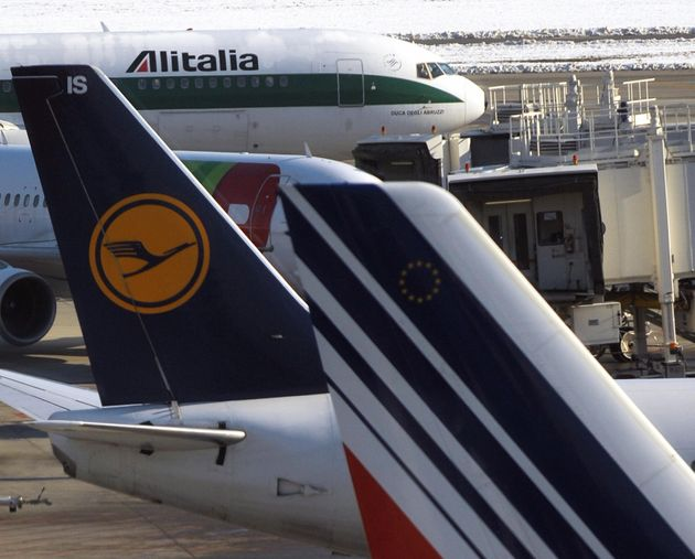 Planes of Alitalia (L), Lufthansa (C) and Air France are parked on the tarmac of Milan's Malpensa Airport...