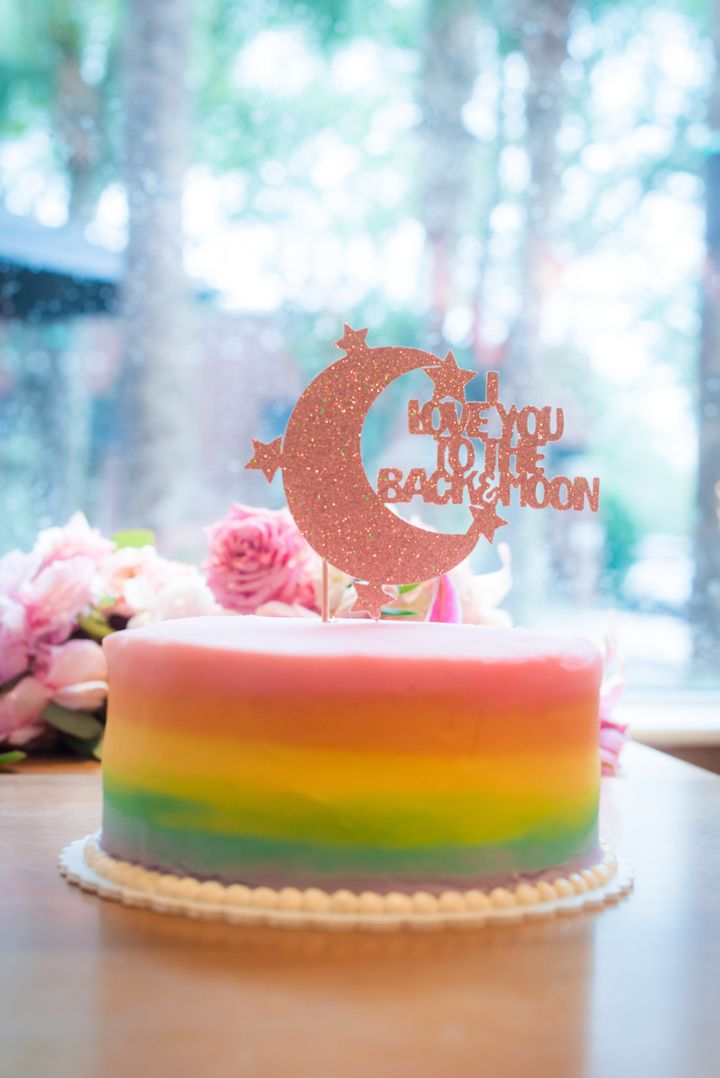 """The cake topper purposely reads: """"I love you to the back and moon"""" because that's how the couple's kids say the phrase."""
