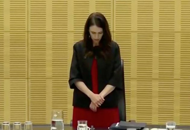 New Zealand's Prime Minister Jacinda Ardern observes a minute of silence, to mark one week since the...