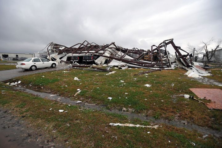 This photo shows some damage from a tornado to the TrimLine building on John Allison Drive in Alexandria, La. (AP Photo/Brad