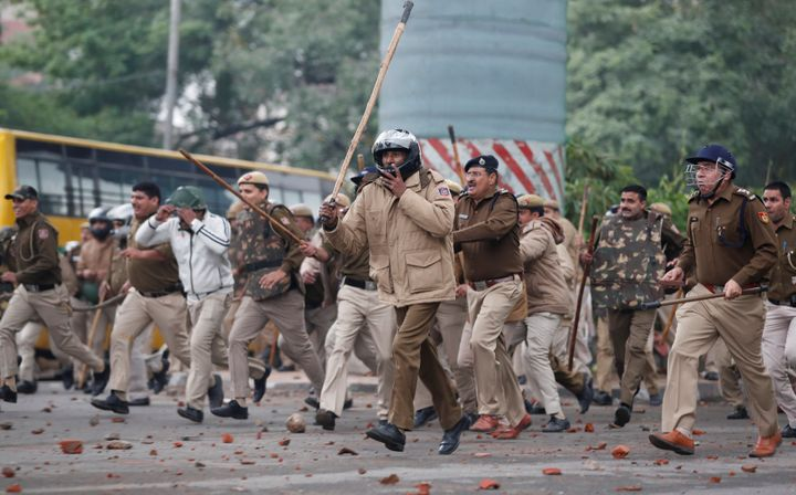 Police officers chase protestors during a protest against the Citizenship Amendment Bill, a bill that seeks to give citizenship to religious minorities persecuted in neighbouring Muslim countries, outside the Jamia Millia Islamia University in New Delhi, India, December 13, 2019. REUTERS/Adnan Abidi