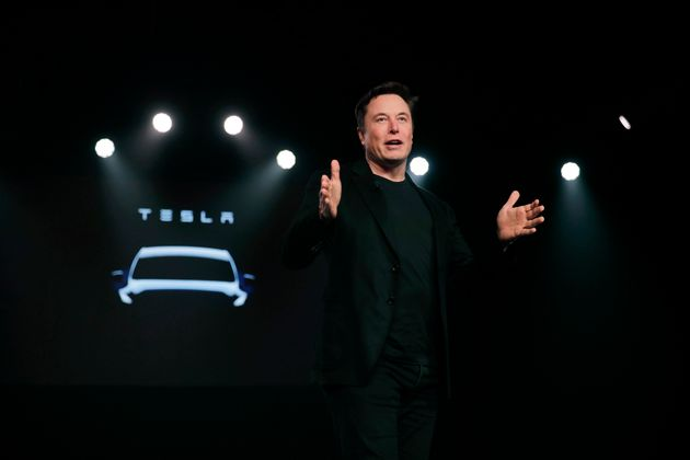 FILE- In this March 14, 2019, file photo Tesla CEO Elon Musk speaks before unveiling the Model Y at Tesla's...