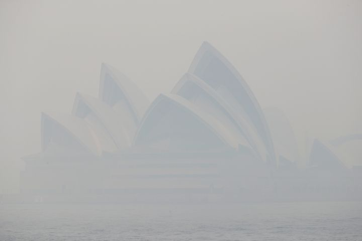 Thick smoke from wildfires shrouds the Opera House in Sydney on 10 December. Hot, dry conditions brought an early start to the fire season.