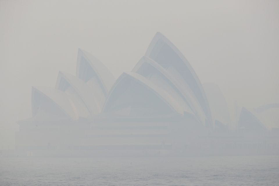 Thick smoke from wildfires shrouds the Opera House in Sydney on 10 December. Hot, dry conditions brought...