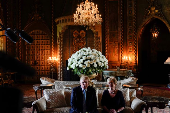 Trump sits with Linda McMahon, the outgoing head of the Small Business Administration, at his Mar-a-Lago estate on March 29,
