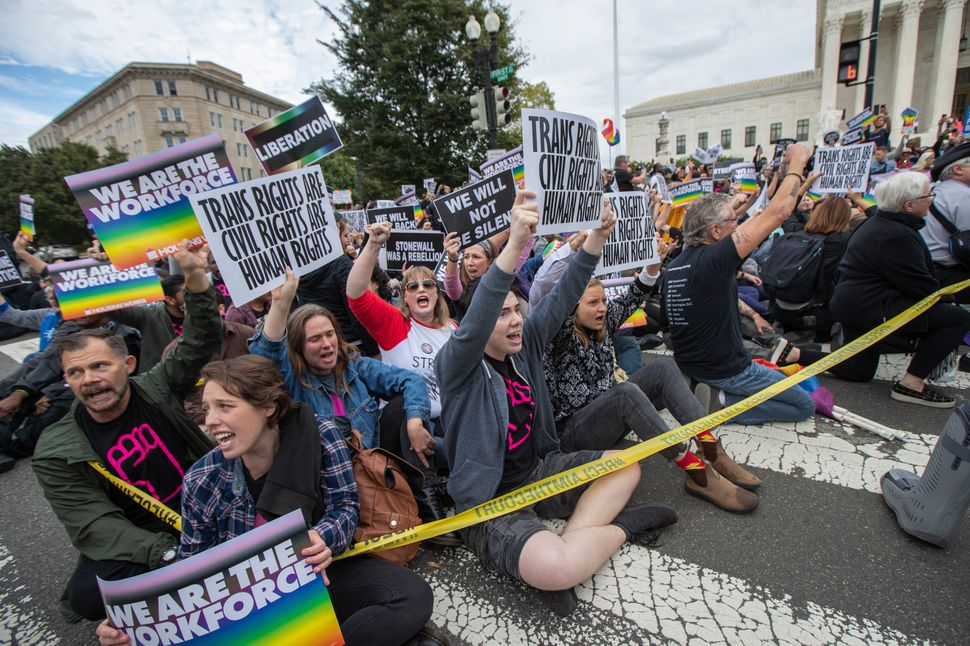 LGBTQ rights protesters demonstrate outside the Supreme Court, which is considering multiple cases that could roll back the l