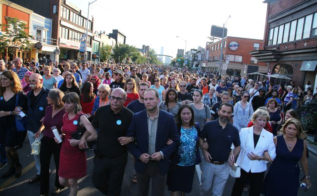 Mourners march in a vigil three days after a mass shooting on Danforth Avenue in Toronto, July 25,
