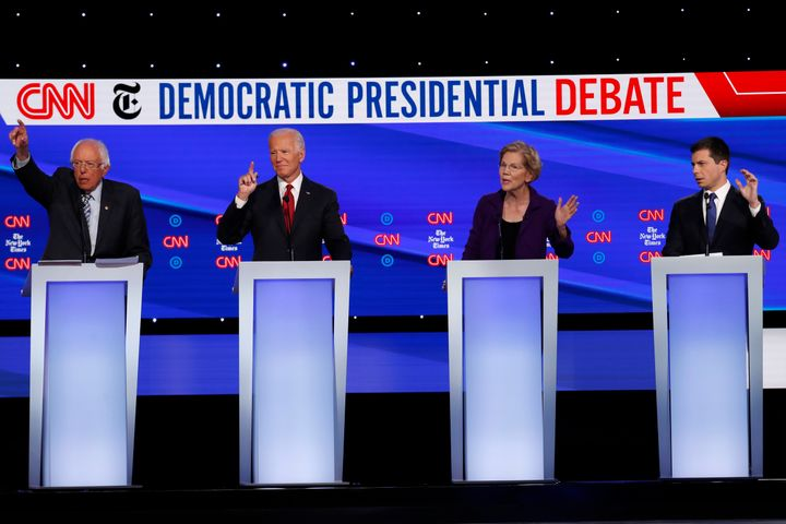 From left, Sen. Bernie Sanders (I-Vt.), former Vice President Joe Biden, Sen. Elizabeth Warren (D-Mass.) and South Bend, Indi