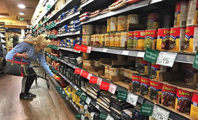 A woman shops at a supermarket in Toronto in this stock photo. A vast majority of Canadians agree their...