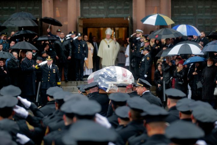 Pallbearers transport the casket of Jersey City Police Detective Joseph Seals in to St. Aeden's church for the funeral servic