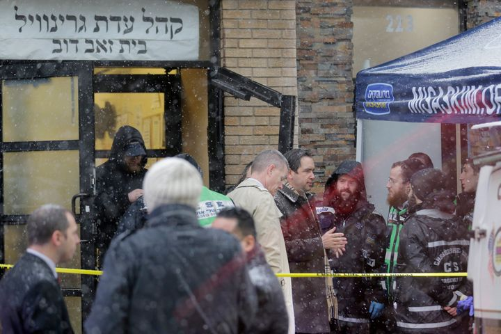 Jersey City's mayor Steven Fulop, center right, talks with first responders at the scene of a shooting in Jersey City, N.J.,