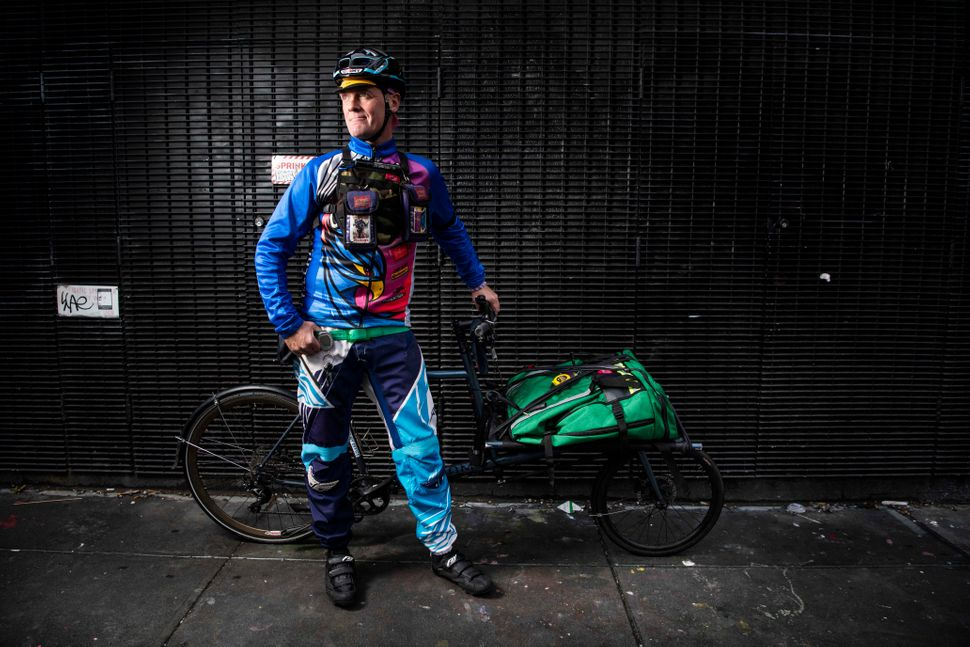 Bolger wears colorful BMX pants from Fly Racing and a cycling shirt made by Primal Wear.