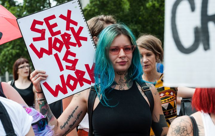 Sex workers and activists protest outside Parliament in London in July 2018, arguing that Britain should not follow the SESTA/FOSTA legislation in the U.S. Protesters say such legislation will make sex work more dangerous by forcing workers out on the streets.