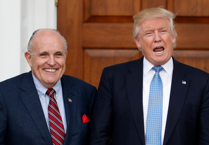 President-elect Donald Trump calls out to media as he and former New York Mayor Rudy Giuliani pose for photographs as Giulian