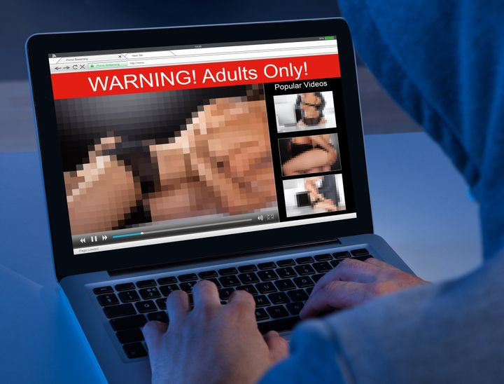 Close-up Of A Person Watching Adult Movie On Laptop