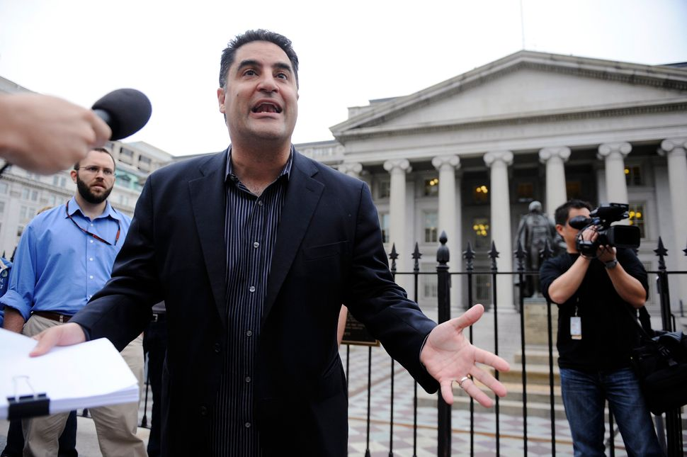Cenk Uygur leads a protest of government bailout money given to Goldman Sachs in front of the U.S. Treasury building in Washi