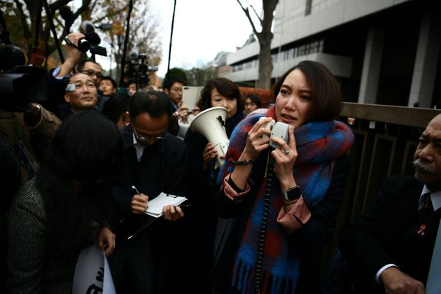 Japanese journalist Shiori Ito speaks to reporters outside the Tokyo district court on December 18, 2019...