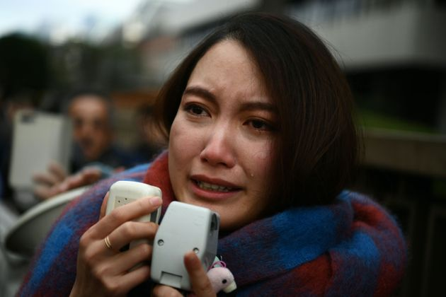Japanese journalist Shiori Ito sheds a tear as she speaks to reporters outside the Tokyo district court...