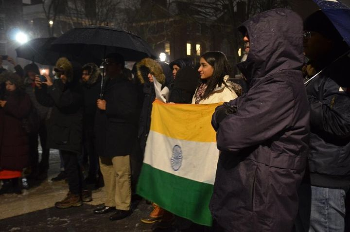 <i>Dr Ruha Shadab holding the Indian national flag at the protest against India's Citizenship Act at Harvard University on December 17, 2019.</i>