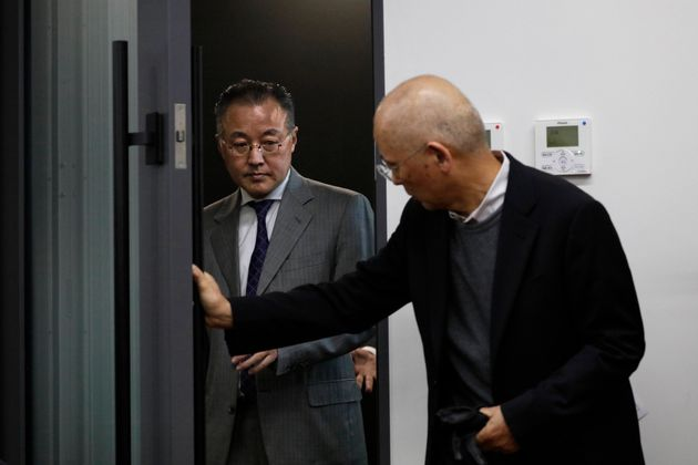 Noriyuki Yamaguchi, left, a former television reporter who is accused of sexually assaulting a female...