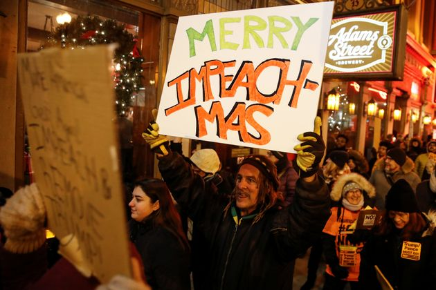 Protesters take part in a rally to support the impeachment and removal of U.S. President Donald Trump...