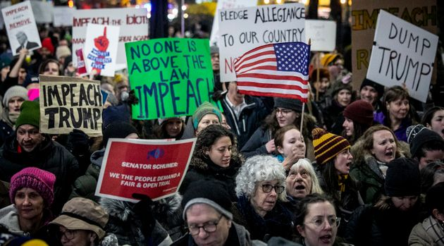 An anti-President Trump crowd gather at a rally to protest and call for his impeachment, Tuesday Dec....