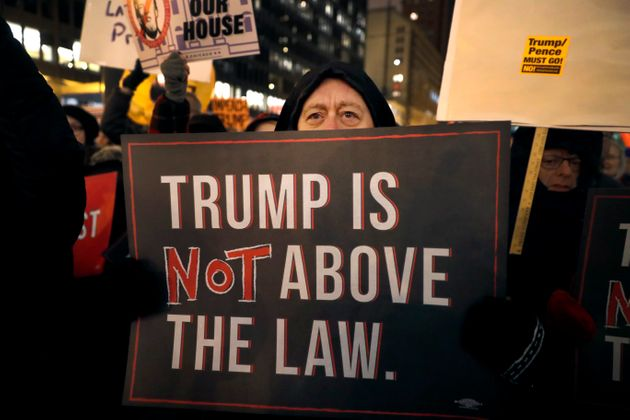 A crowd gathers on Federal Plaza for a protest against President Donald Trump on the eve of a scheduled...