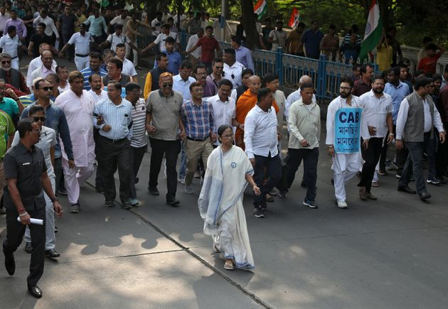 Mamata Banerjee, the Chief Minister of West Bengal, and her party supporters attend a protest march against...