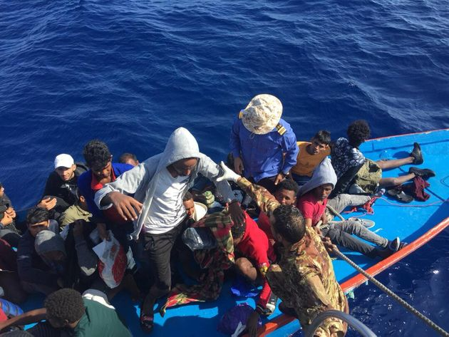 Migrants are seen in a dinghy as they are rescued by Libyan coast guards in the Mediterranean Sea off...