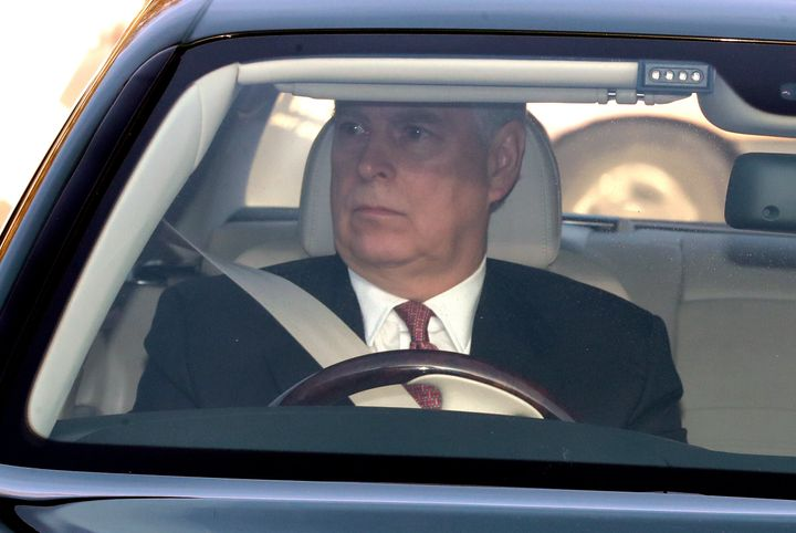 The Duke of York drives his Bentley into the Buckingham Palace grounds in London as he arrives for Queen Elizabeth II's Chris