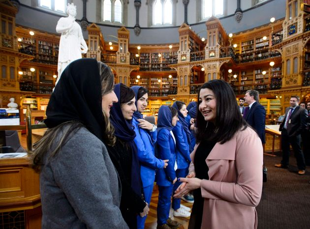 Maryam Monsef meets members of the Afghan Dreamers team in the Library of Parliament on Parliament Hill...