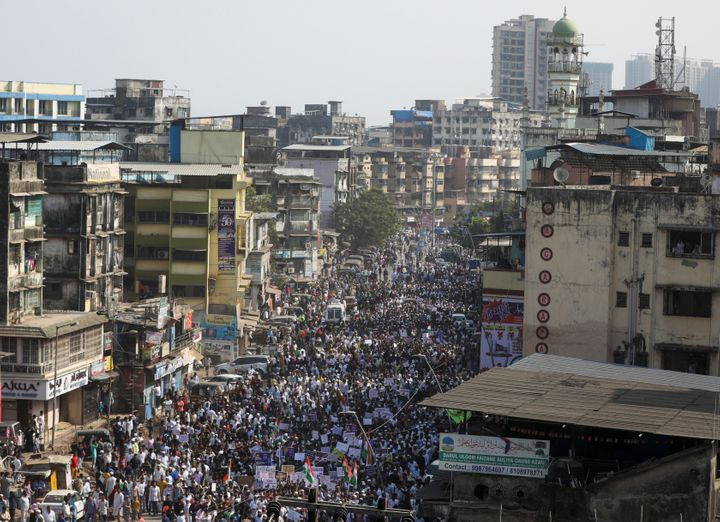 Demonstrators walk during a protest march against a new citizenship law, on the outskirts of Mumbai, India, December 18, 2019