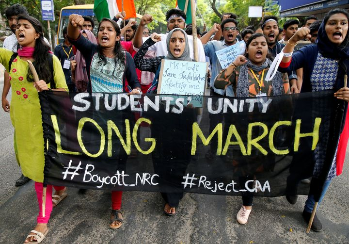 Students shout slogans during a protest march against a new citizenship law, in Kochi, India, December 18, 2019.