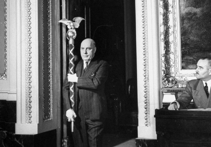 The sergeant-at-arms carries the ceremonial mace into the House of Representatives in 1941.