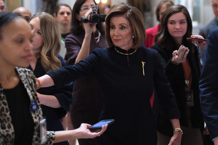 House Speaker Nancy Pelosi (D-Calif.) as she headed toward the House floor on Wednesday to open the chamber's debate on impea