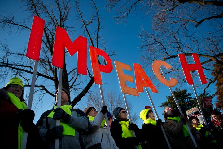 People rally in support of the impeachment of President Donald Trump in front of the Capitol as the House of Representatives