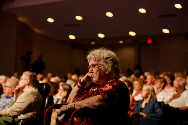 The audience listens to presidential hopefuls speak at an AARP forum in Council Bluffs, Iowa, in July. Older generations vote