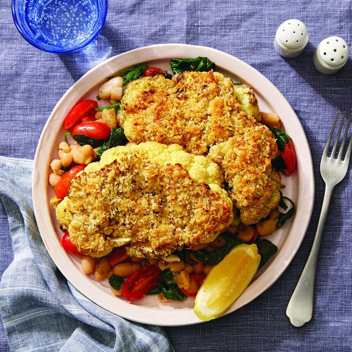 """One of Blue Apron's new WW-approved recipes for 2020 includes this&nbsp;<a href=""""More enjoying food with family and friends, less counting of points behind the scenes, please."""" target=""""_blank"""" rel=""""noopener noreferrer"""">parmesan-crusted cauliflower steaks with white bean saut&eacute; and lemon</a>, which also happens to have &ldquo;Plant Forward&rdquo; and &ldquo;Carb Conscious&rdquo; labels, too.&nbsp;"""