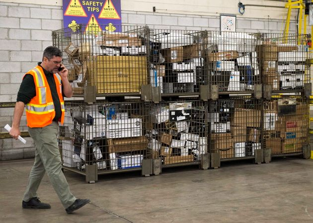 Containers full of parcels await delivery at Canada Post's Gateway location in Mississauga, Ont. on Jan....