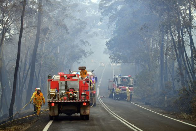 Firefighters work to extinguish a bushfire in Dargan, some 120 kilometres from