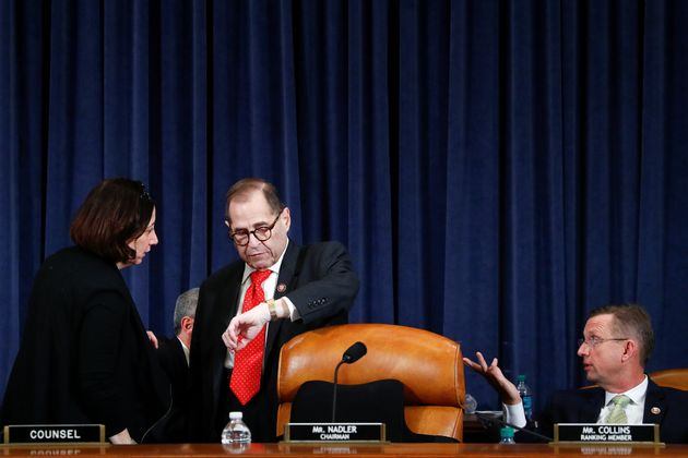 Committee Chairman Jerome Nadler (D-N.Y.) speaks to a congressional staff member during a brief recess,...